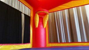 ball hoop inside banner bounce house